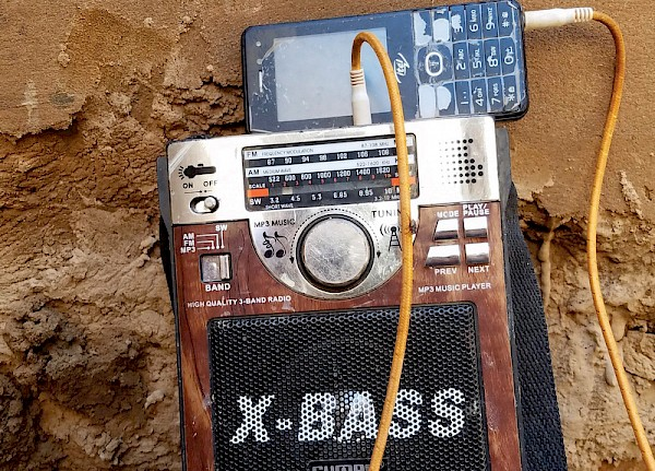 "Literally 'Music from Saharan Cellphones,' which was also the title  of one of Sahel Sounds' first releases—""a compilation of music collected from memory cards of cellular phones in the Saharan desert"""