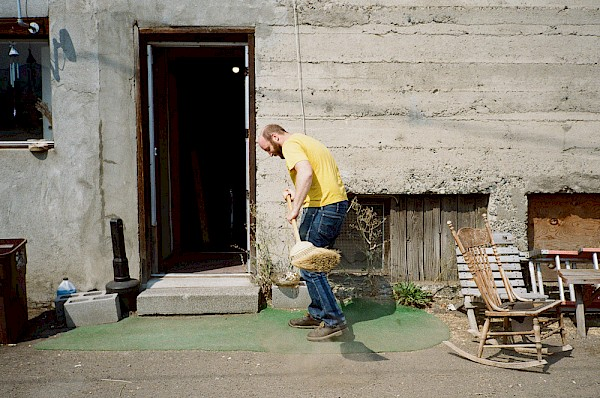 Budwig tidying up the famous AstroTurf behind the OK Theatre: Photo by Matt Kennelly