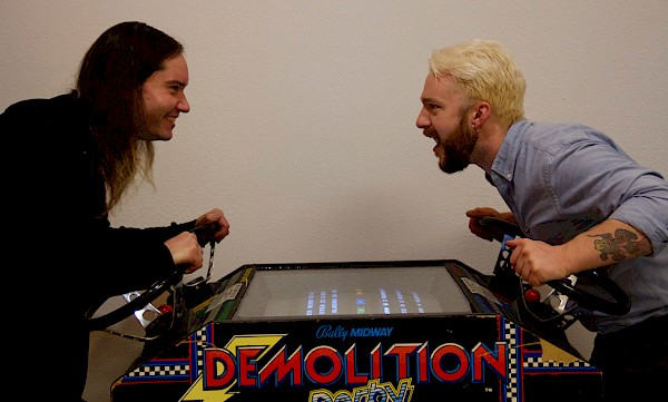 Hawthorne Game Exchange's Skyler Stimson and Chris Hanson playing Demolition Derby: Photo by Jose Amandor