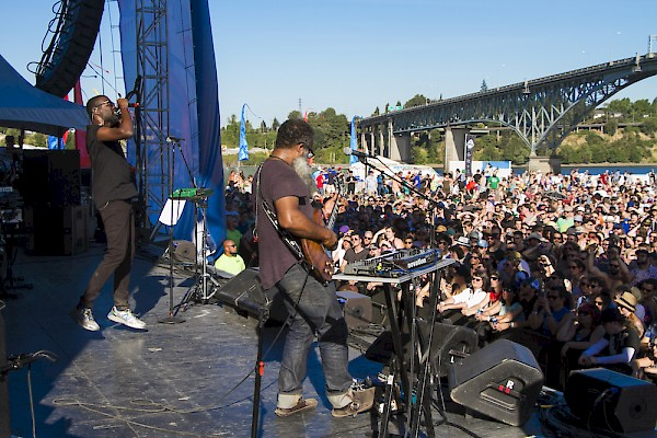TV On The Radio's Tunde Adebimpe and Kyp Malone look out towards the Ross Island Bridge