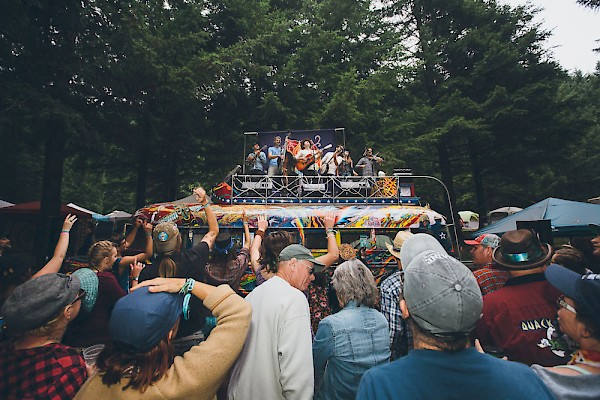 The Brothers Comatose atop the Furthur Bus at Northwest String Summit at Horning's Hideout in 2016—click to see more photos by Jessie McCall