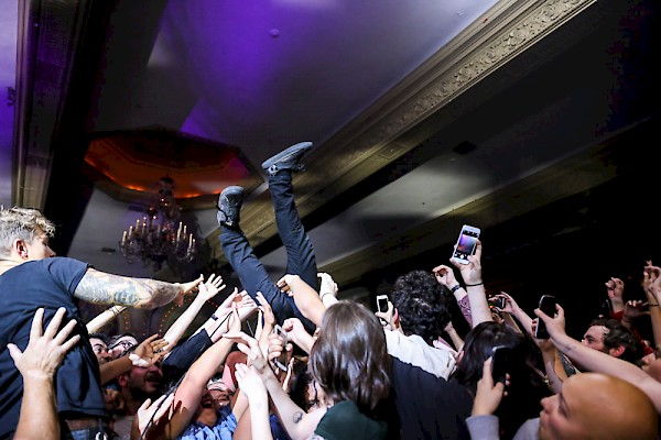 Yannis Philippakis surfing the Crystal crowd—click to see more photos by Sydnie Kobza