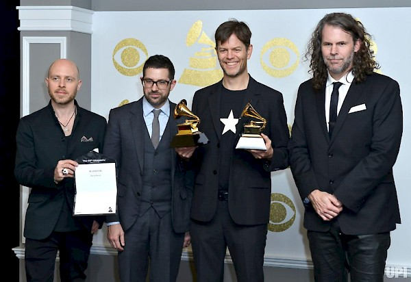 McCaslin (with Lindner, Guiliana and Lefebvre) at the 2017 Grammys, after accepting an award on behalf of David Bowie