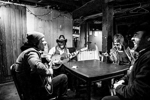 Taylor Kingman, Lewi Longmire, Little Sue and Brad Parsons jamming out in the LaurelThirst's basement