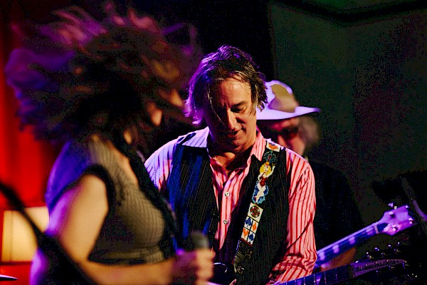 Peter Buck, with Sleater-Kinney's Corin Tucker in the foreground and Scott McCaughey of The Minus 5 and Young Fresh Fellows behind, opening for himself in 2014 as part of the supergroup that would become Filthy Friends—click to see more photos by Jason Quigley