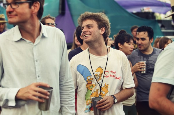 Mac DeMarco enjoying some tunes and his reusable aluminum cup
