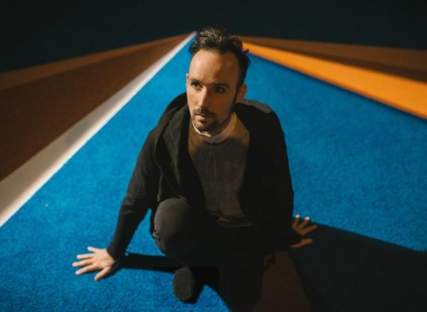 Holcombe Waller posing on the carpeted deck of his spaceship: Photo by Tyler Kalberg