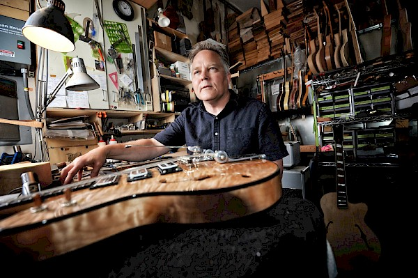 Guitar freak heaven: Koll in his systematically stuffed SW Portland workshop where blocks of wood become beautifully finished musical muses: Photo by Miri Stebivka